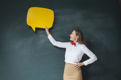 Young woman with speech bubble stock images