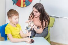 Free Young Woman Speech Therapist Is Engaged In The Office With A Child Stock Photo - 190944410