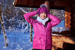 Young woman spend winter holidays at mountain cottage Stock Image