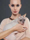 Young woman with Sphynx cat Stock Photography