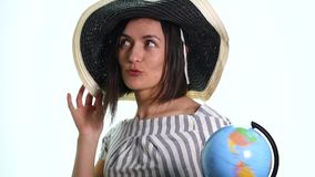 Young woman spinning a globe, deciding where to go on vacations.  stock video footage
