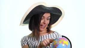 Young woman spinning a globe, deciding where to go on vacations.  stock footage