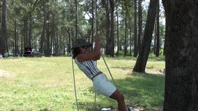 Young woman spinning on rope 2 stock video