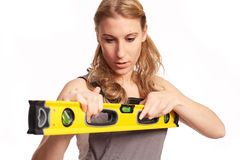 Young woman with a spirit level Stock Photography