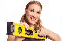 Young woman with a spirit level Royalty Free Stock Photos