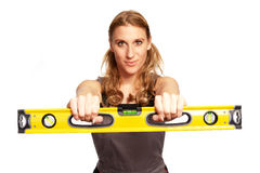 Young woman with a spirit level Stock Photo