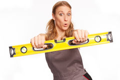Young woman with a spirit level Stock Images