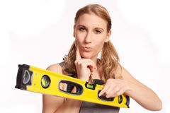 Young woman with a spirit level Royalty Free Stock Photo