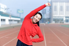 Young woman in sport wear doing sport Royalty Free Stock Image