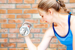 Young woman in sport wear exercising in sport club Stock Images