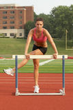 Young Woman in Sports Bra Warming-up on Hurdle Stock Image