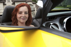 Young woman in a sports car. Wealthy young woman in a sports car Royalty Free Stock Image