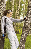 Young woman in sports clothing standing between two birches Royalty Free Stock Photos