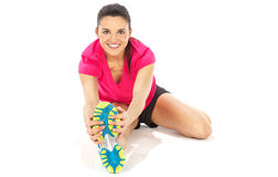 Sport woman stretching  on white Royalty Free Stock Photo