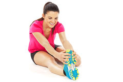Sport woman stretching  on white Royalty Free Stock Photography