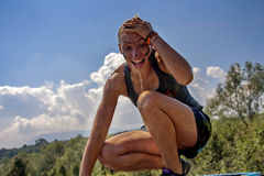 Young woman during sports physical challenge. Young Caucasian woman, overcome, sport, physical challenge, water dripping from woman`s face Royalty Free Stock Photography