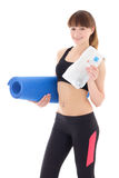 Young woman in sports wear with bottle of water and mat isolated Royalty Free Stock Images