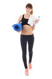 Young woman in sports wear with bottle of water and yoga mat iso. Lated on white background stock image