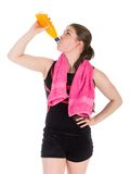 Young woman in sports wear drinking orange juice. isolated over white royalty free stock image