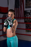 Young woman in sportswear and in boxing gloves training Royalty Free Stock Photo