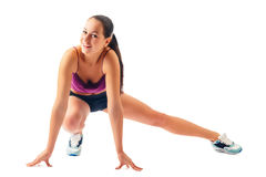 Young woman in sportswear does exercises Royalty Free Stock Photo