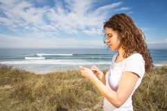Young woman with sportswear looking her smartphone Stock Photography