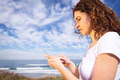 Young woman with sportswear looking her smartphone Royalty Free Stock Photo