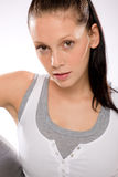 Young woman in sportswear on white background Stock Photo