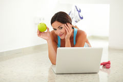 Young woman in sportswear working on computer Stock Photo