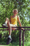 Young woman in sportswear working out outdoors in a park on sunn Royalty Free Stock Images