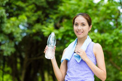 Young woman with sportwear and holding with water bottle. At outdoor Royalty Free Stock Photos