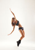A young woman in sporty clothes dancing Stock Image