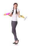 Young woman with spray bottle and brush Stock Image