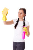 Young woman with spray bottle and sponge. Stock Photo
