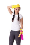 Young woman with spray bottle and sponge. Royalty Free Stock Photography