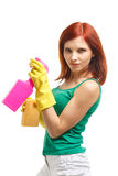 Young woman with spray bottle and sponge. Royalty Free Stock Photos