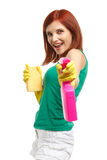 Young woman with spray bottle and sponge. Royalty Free Stock Image