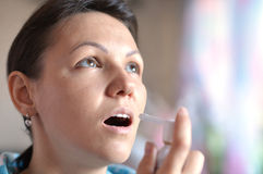 Young woman with spray inhaler Stock Image
