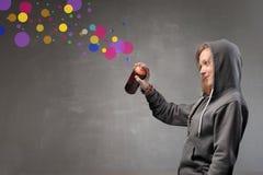 Young woman spraying stock image
