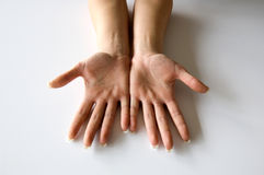 Young woman spread fingers on hands. Young woman spread fingers and palms Stock Image