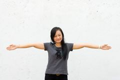 Young woman spread her arms wide open royalty free stock images