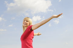Young woman spreads her arms Stock Photography