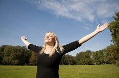 Young woman spreads her arms Royalty Free Stock Photos