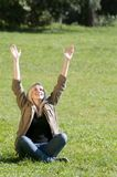 Young woman spreads her arms Royalty Free Stock Photo