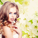 Young Woman on Spring Background Stock Image