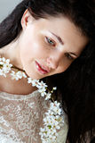 Young woman with spring blossom without make-up Stock Photo