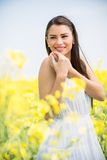 Young woman in the spring field Royalty Free Stock Photography
