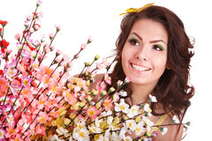 Young woman with spring flower and butterfly. Stock Photography