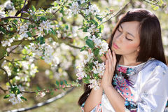 Young woman with spring flowers Royalty Free Stock Images