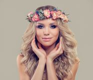 Young Woman with Spring Flowers. Facial Treatment. Aesthetic Medicine and Cosmetology Concept royalty free stock photos